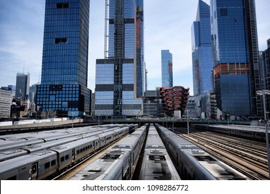 New York, USA, April 09, 2018:Hudson Yards train depot from the High Line. New York City skyline with urban skyscrapers. Spring view from elivated public park with decorative pipes as art work.