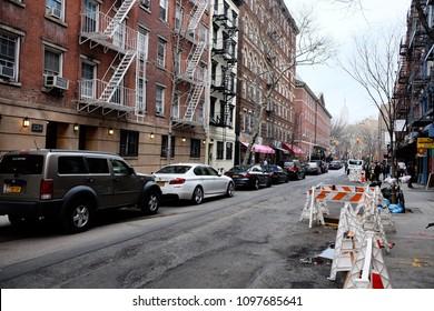 New York, USA, April 13, 2018:Residential buildings in historic Greenwich Village neighbourhood of Manhattan, New York City. Street spring view.