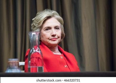 NEW YORK, USA - APRIL 13, 2016: Hillary Clinton sits near a bottle of water on a table as she prepares to deliver a speech at the 25th annual NAN convention.