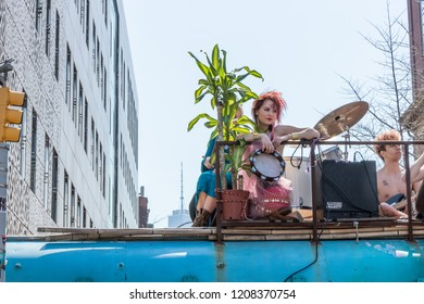 NEW YORK, USA - APRIL 14, 2018: Abracadabra Field Trip. Creative wears and strangest alter-egos to the streets in live concert on the roof of th The BlueByrd Bus in New York, USA