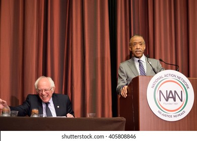 NEW YORK, USA - APRIL 14, 2016: Presidential candidate Bernie Sanders prepares to speak at the National Action Network convention. Reverend Al Sharpton introduces Sanders as he gets a cup of water.