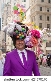New York, New York, USA- April 16,2017. Man in a highly decorated hat, poses for spectators at the annual Easter Bonnet Parade.