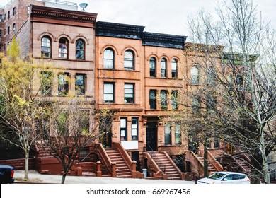 NEW YORK, USA - APRIL 17, 2017: The street of New York at APRIL 17, 2017. Harlem Manhattan New York. Classic luxury apartment building in New York City. Beautiful american street.