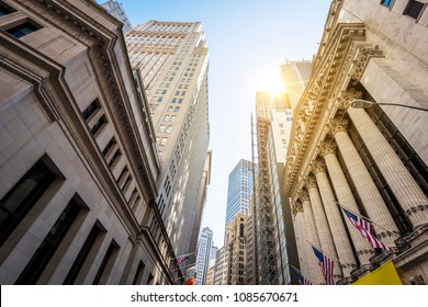 NEW YORK, USA - APRIL 20, 2018: The rustic architecture of Wall Street in New York city with the New York Exchange and surrounding buildings.
