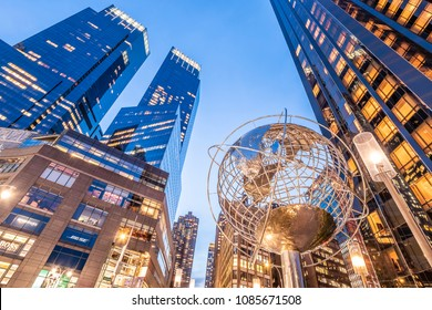 NEW YORK, USA - APRIL 20, 2018: The modern architecture of New York city in the USA at Columbus Circle with skyscrapers and famous globe at sunset.