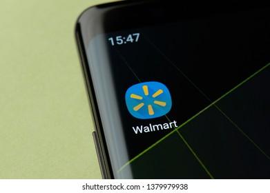 New york, USA - April 22, 2019: Wallmart shop icon macro view on smartphone screen desktop