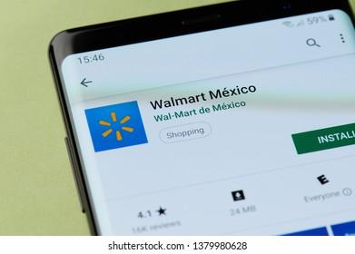 New york, USA - april 22, 2019: Installing walmart shopping to smartphone app from google market