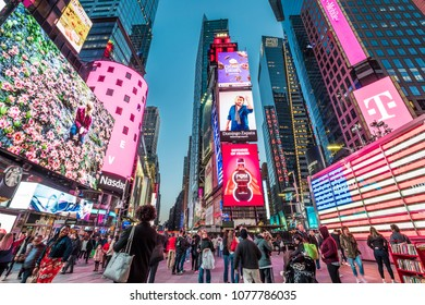 NEW YORK, USA - APRIL 23, 2018: The architecture of New York city in the USA showcasing Times Square with its neon billboards, stores, and tons of tourists passing by