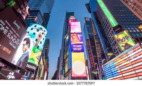NEW YORK, USA - APRIL 23, 2018: The architecture of New York city in the USA showcasing Times Square with its neon billboards and sore fronts at night.