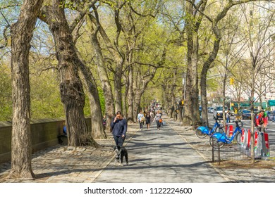New York, USA - April 26,2018 : People walking on footpath between 5th Ave. and Central Park in New York,USA on April 26,2018.