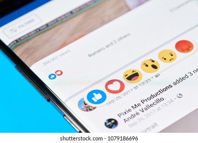 New york, USA - April 27, 2018: Reaction on feed in facebook close-up on mobile screen