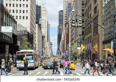 NEW YORK, USA - April 27 2016: Unknown people who walked across the road on crosswalk to cross the street in New York City, USA.