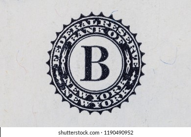 New York, USA - April 29, 2018: Close-up of the United States Federal Reserve Bank of New York logo on a banknote of ten US dollars