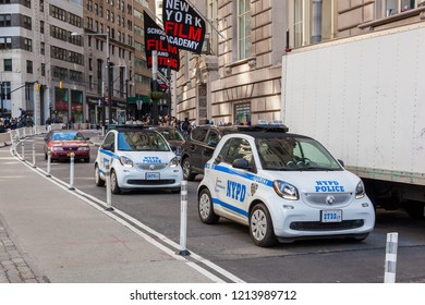 New York, New York / USA - April 5, 2018: Two NYPD Smart Cars drive near Bowling Green in Lower Manhattan.