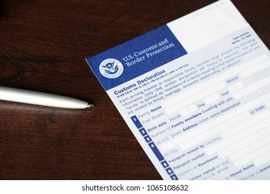 New york, USA - April 9, 2018: Empty US customs declaration form laying with pen on wooden table