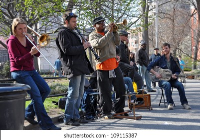 NEW YORK, USA - APRIL 9: Traditional Jazz Band playing dixieland music for the lunch time crowd in Washington Square, Greenwich Village on April 09, 2008 in New York.