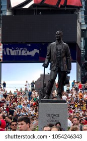 New York, USA - Aug 17, 2016: George M Cohan Statue place in Times Square, background with neon advertising board