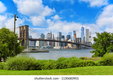 New York, USA- August 07, 2017 :  View Brooklyn Bridge between the Lower Manhattan and Brooklyn from Empire Fulton Ferry State Park.