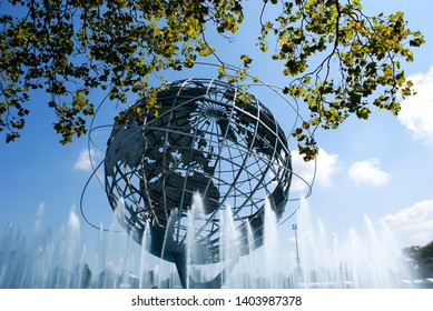 New york, usa - August 15, 2008: Metal sculpture of the terrestrial globe on a water source, concept of internationalization and globalized economy.