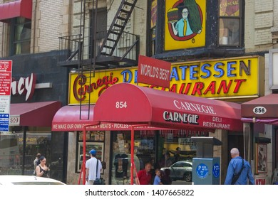 NEW YORK, NEW YORK / USA - AUGUST 16 2009: Front entrance and signage of the world-famous Carnegie Deli delicatessen restaurant on 7th Avenue in mid-town Manhattan.