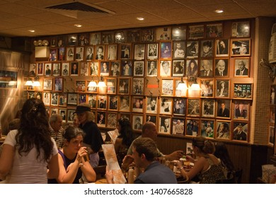 NEW YORK, NEW YORK / USA - AUGUST 16 2009: Autograph picture wall of many celebrities who ate at the world-famous Carnegie Deli delicatessen restaurant on 7th Avenue in mid-town Manhattan.