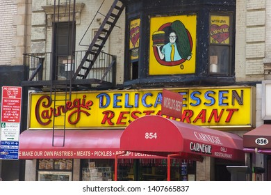 NEW YORK, NEW YORK / USA - AUGUST 16 2009: Front entrance and signage of the famous Carnegie Deli delicatessen restaurant on 7th Avenue in mid-town Manhattan.