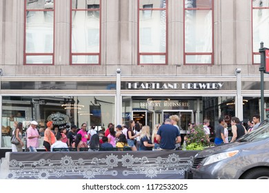 New York, USA, August 18, 2018: People walk by Heartland Brewery in New York City.