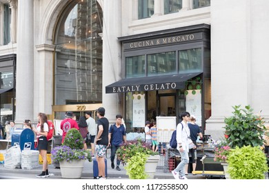 New York, USA, August 18, 2018:People inside Eataly shop in Manhattan. Eataly is a high-end Italian food market/mall