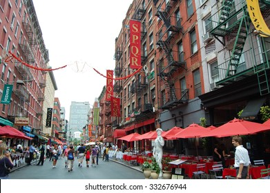 New York, USA - August 19, 2012: street scene with people and restaurants in Little Italy in New York City. The area known for its Italian heritage & culture attracts many tourists.