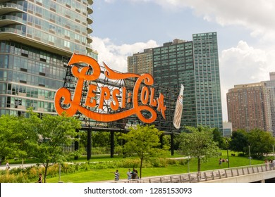 New York, USA - August 20, 2018: Long Island City waterfront with landmark Pepsi Cola sign. This historic 147 foot sign once on the Pepsi Factory is now located at Gantry Plaza State Park in Queens