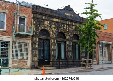 New York, USA - August 20, 2018: historical building at 33 Grand St, Williamsburg Brooklyn. It was the home of the North Side Bank since 1889. Designed by Theobald Engelhardt in Romanesque Revival