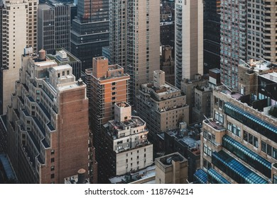 New York/ USA - August 2018: View of rooftops and streets in Midtown Manhattan from a vantage point. Showcasing architecture dominated by tall buildings and skyscrapers