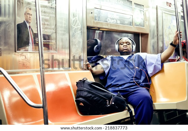 NEW YORK. USA - AUGUST 21, 2012: American African man listening to music in subway on August 21, 2012, New York, USA