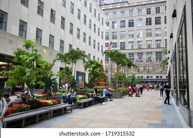 New York, USA – August 23, 2018: Rockefeller Plaza, Beautiful blooming flower, fountain and sculpture in the Channel Gardens at Rockefeller Center, New York.