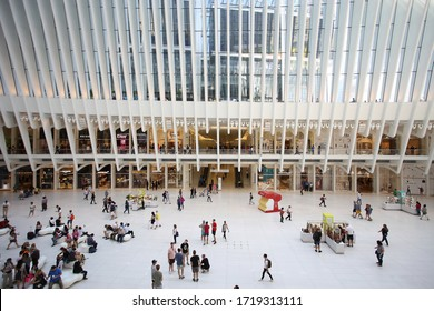 New York, USA – August 24, 2018: Oculus interior of the white World Trade Center station with people in New York City, The structure was designed by architect Santiago Calatrava.