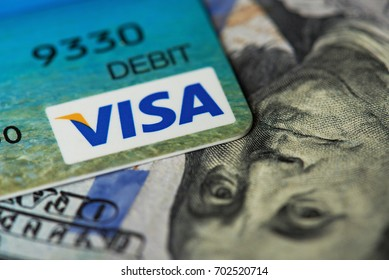 New york, USA - August 24, 2017:Close-up of visa card on dollar bill background
