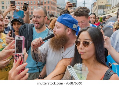New York, USA - August 25, 2017: Action Bronson, is an American rapper, singing among his fans in front of the Gansevoort Market, in Manhattan.