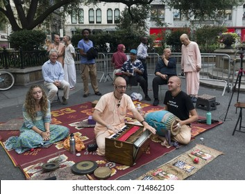 NEW YORK, NEW YORK, USA - AUGUST 25: Hare Krishna people chant on 14th street and Union Square NYC.  Taken August 25, 2017 in New York.