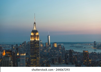 NEW YORK, USA - AUGUST 26, 2014: Empire State Building and Manhattan Cityscape at Dusk with Freedom Tower on background