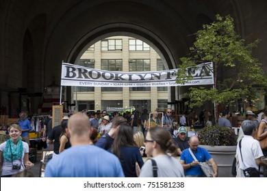 NEW YORK, USA - AUGUST 27, 2017: Unidentified people at Brooklyn Flea market in New York. Brooklyn Flea is one of New Yorks top flea markets.