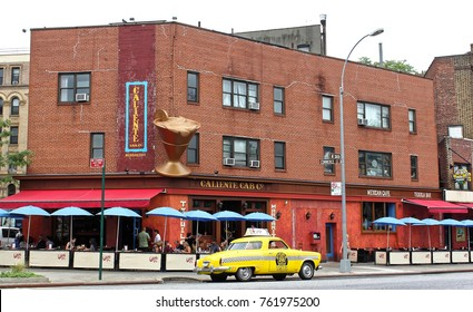 New York, USA - August 3, 2014: 1950 Studebaker yellow taxi outside the Caliente Cab restaurant on Seventh Avenue South in Greenwich Village in New York City