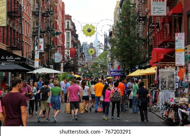 New York, USA - August 3, 2017: Busy street with pedestrians in Little Italy in New York city