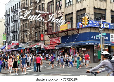 New York, USA - August 3, 2017: Busy street with pedestrians in Little Italy with a welcome sign in New York City