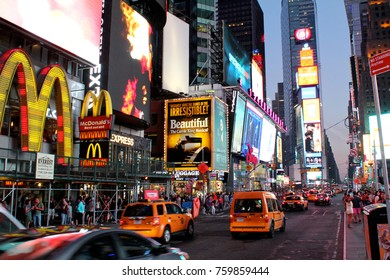 New York, USA - August 5, 2014: Times Square by night is a major commercial intersection, tourist destination, entertainment center and neighborhood in the Midtown Manhattan section of New York City