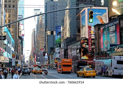 NEW YORK, USA - August 5, 2014: Rush hour with yellow cab on 7th av. in Manhattan before sunset. Seventh Avenue is southbound below Central Park and a two-way street north of the park.