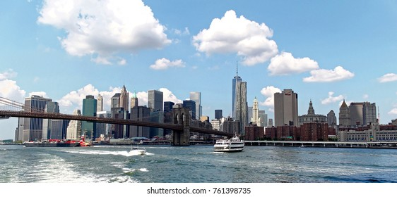 New York, USA - August 5, 2014: New York city Lower Manhattan skyline and Brooklyn bridge viewed from a boat