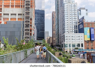 NEW YORK, USA - AUGUST 9, 2017: People walking along the High Line  on August 9, 2017, New York, USA. The High Line  is a 1.45-mile-long (2.33 km) elevated linear park on the west side of Manhattan.