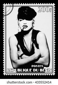 NEW YORK, USA - CIRCA 2010: A postage stamp printed in the Republic of Benin showing Madonna Louise Ciccone, circa 2002