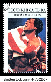 New York, USA - CIRCA 2010: A postage stamp printed in Russia showing Hollywood movie star Sylvester Stallone wrapped in an American flag shot during the Rocky movie, circa 2005