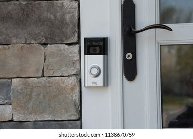 New York, USA - Circa 2018: Ring video doorbell owned by Amazon. manufactures home smart security products allowing homeowners to monitor remotely via smart cell phone app. Illustrative editorial